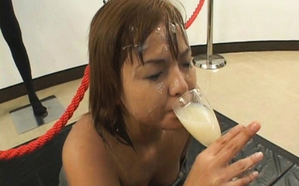 Asian babe in bukkake action