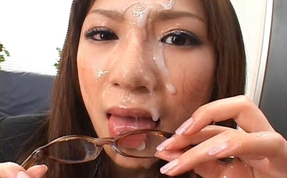 Natsu Ando Naughty Asian secretary enjoys bukkake